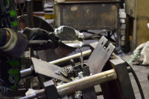 Non-Ferrous Metal - Eagle Aluminum operator pouring molten aluminum into a mold