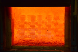 Induction Heating - Molds glow with heat inside an induction furnace