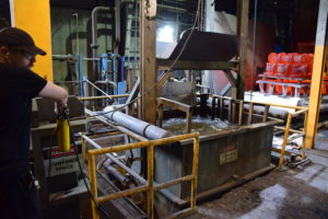 Heat Treatment - An Eagle Alloy operator dunks red-hot parts into a water bath to harden the material