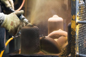 Venting - an Eagle Alloy operator manually opens a mold to allow gases to escape